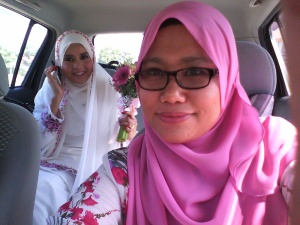 on our way to akad nikah :) fisha was driving